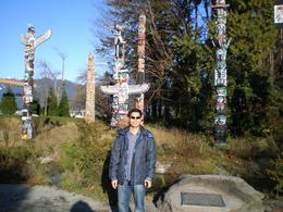 Eight totem poles at Stanley Park, Shir Ling L - December 2009