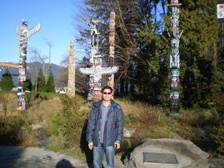 Eight totem poles at Stanley Park