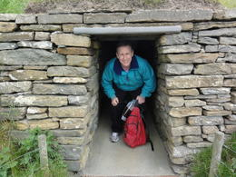 Me inside the entrance to a reconstructed stone-age home at Skara Brae. , William B - July 2013