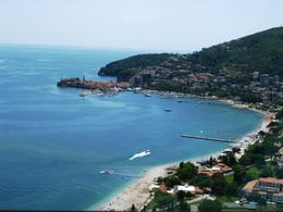 Beaches in Budva, and the small peninsula with the Old Town of Budva in the distance , BethanieKay - May 2013