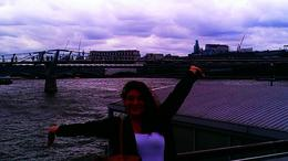 This is me on the boat ride part of the tour on the Thames River. The Millennium Bridge behind me famous in the 6th Harry Potter movie Harry Potter and the Half-Blood Prince. , Kristen A - July 2013