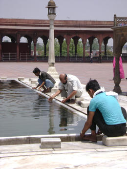 Worshipers must wash their hands and feet before praying. This pool is in the center of the mosque , Balti-most - May 2011