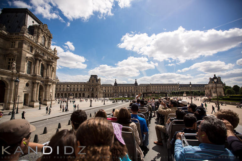 The entrance of the Louvre from the tour bus - Paris