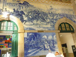 Virginia took us to the train station to experience the history of Porto that was done by local artists on tiles that were placed on the walls of the train station. It was exciting to learn about..., Cynthia P - October 2013