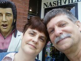 Stopping for a photo with Elvis on our walking tour. , David L - May 2011