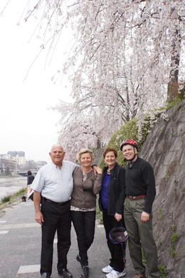 The four of us stopping to take photos of the sakura blossoms along the river. , Nita - April 2014
