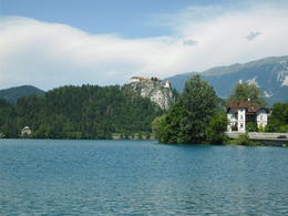 Bled castle and church from the boat transporting us to the island. , Rodney L - August 2012