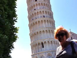 My wife in the front of the Pisa Tower taking advantage of a Bus Stop , Eddy - July 2011