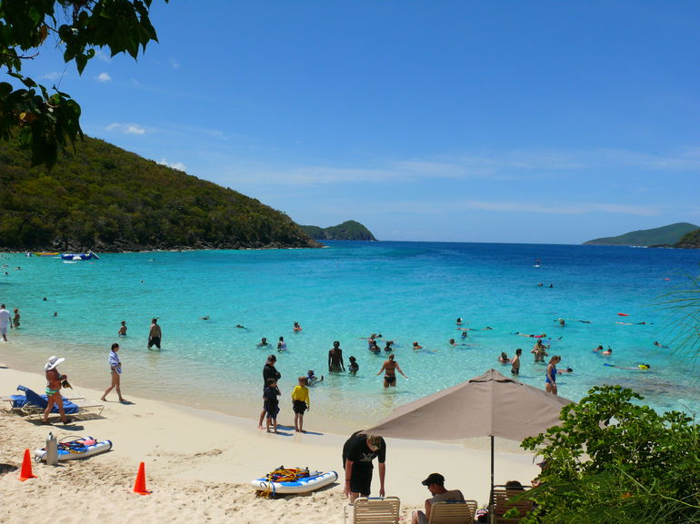 Notice all of the people snorkeling. Coki beach ha hundreds of colorful and very friendly fish just begging to be filmed.