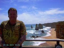 I was by myself on this tour so it was nice of a fellow passenger (who unkonwingly to me was staying at the same hotel as me) to take a photo of me with the Apostles in the background. I plan to ... , Geoff P - January 2011