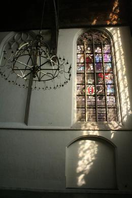 This church is enormous and is filled with beautiful stained glass windows. It is said to be the only building in Amsterdam virtually unchanged since Rembrandt buried his wife Saskia here in 1642.  ...  - April 2008