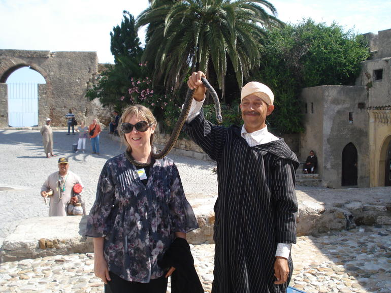 Playing with snakes in Morocco - Costa del Sol