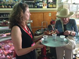 Sofia handing out tasty samples of cheese, quince paste, and port. , Sharlene E - June 2015