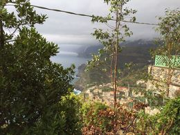 Towards the center of the picture you can see a funnel cloud hovering over either the Vernazza or Monterosso towns of Cinque Terre!! , Ken - October 2015