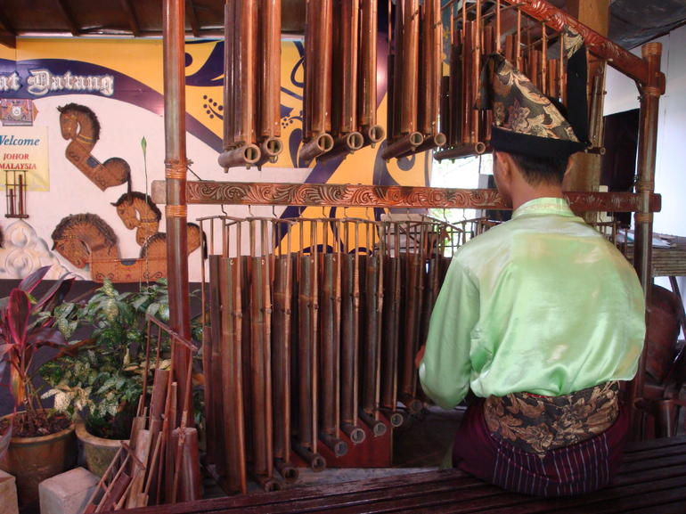 guy playing an instrument - Singapore