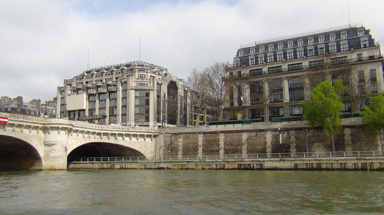 A view of one of the many bridges along the Seine River. - Paris