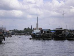 This is the floating market on the Mekong Delta, as you can see very different to the photo advertised, very disappointing. The photo was taken from our boat by myself of what was meant to be the ... , SUZANNE S - April 2008