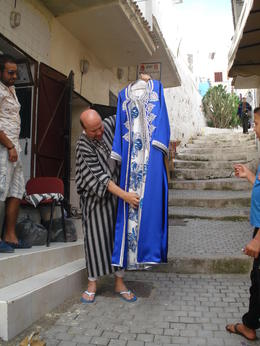 Our tour guide introduced us to the gentlemen who made the dress he is exhibiting. The entire street was filled with rooms in which these dresses and other clothing were being made by hand. , David F - August 2011