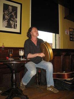 A man playing the Bodhran, an instrument invented in Ireland. He played a song that he heard as a child -- it's only voice and Bodran. - June 2009