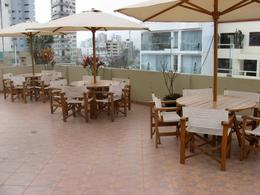 Photo of Lima Lima Market Tour, Cooking Class and Pisco Sour Lesson Tables at the Rooftop Bar
