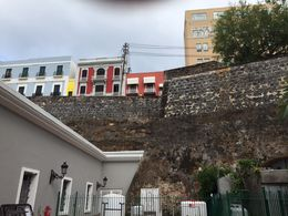The original walls and a house that is now in the space of a former alley way , DIANNE W - November 2015