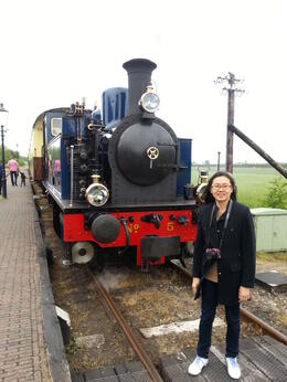 Standing in front of a steam train that had just pulled over. It chugged through beautiful farmlands which are close to the horses, sheeps and cattles, and residential area. The crew onboard are..., CLARE C - June 2013