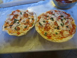Our two wonderfully made pizza by our own hands! You actually got to make yourself two pizza's or a pizza and a calzone. Enough food to get super full....plus our gelato we made! , Connie C - June 2012