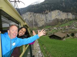 Our tour guide took this photo of my husband and me, with the beautiful Swiss countryside in the background. , TINA M - May 2014