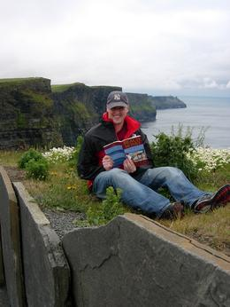 "Curtis Lewsey reading ""Beach Money"" at the Cliffs of Moher., Curtis L - June 2008"