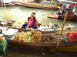 This is one of the colorful vendors at the floating market. , Janet - November 2012