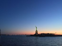 A view of the Statue of Liberty at Sunset. This was taken with my iPhone - as I didn't have a better camera with me. With a better camera you can get a very good view of the statue. It appears much, ... , Holly C - April 2016