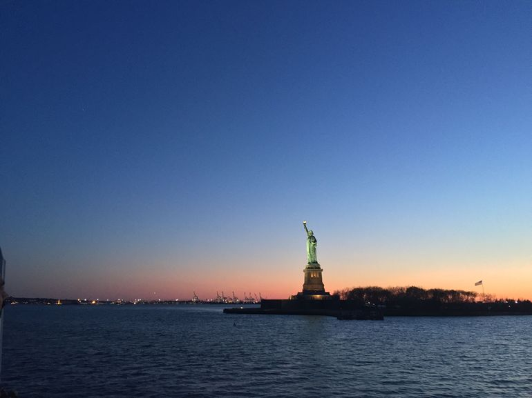A view of the Statue of Liberty at Sunset