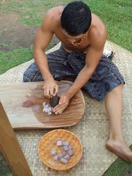 A guy is showing how poi(taro paste) is made , Natallia R - May 2013