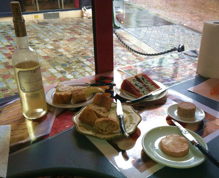Latin Quarter food tour sampling - three types of frommage; baguette, frois gras, pate, accompanied by sweet white wine.