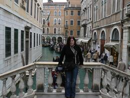 This is my lovely girlfriend on a bridge with some gondolas in the background, just outside of St Mark's Square., Tim S - April 2008