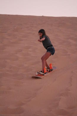 My 10 yr. old daughter trying sand boarding. , Monica R - November 2011