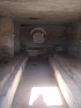 Temple to the God Mithras, a Persian religion also known as Zoroastrianism. It holds many traditions that we adopted by Christianity. Shown are the benches inside of the dark chamber in which the..., Amy D - November 2008