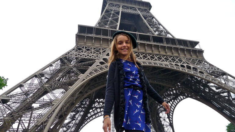 Our granddaughter getting ready for an Eiffel Tower tour. - Paris