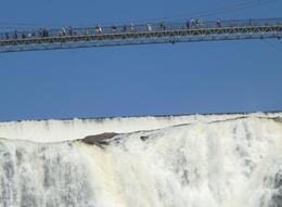 Photo of Quebec City Half-Day Trip to Montmorency Falls and Ste-Anne-de-Beaupré from Quebec Montmorency Falls with bridge over.