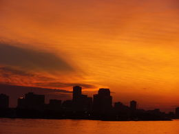 Photo of   Sunset over the New Orleans skyline from the Steamboat Natchez