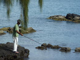 A fisherman casts his line in a bay in Hilo. , kolivari - February 2011