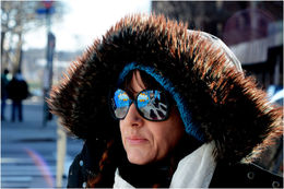 The photo shows Lady K Fever, a Canadian Street artist now living in East Harlem, our tour guide on the walk. Her glasses reflect the mural of Booga, a local, who was shot by a retired policeman ... , Tracey A - February 2015