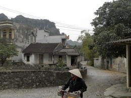 Photo of Hanoi Small-Group Vietnamese Countryside Tour by Bike and Boat from Hanoi passing thru a village