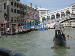 On the water bus on grand canal loking bcak at Rialto bridge , Christine P - May 2011
