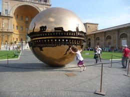 Our tour guide Anna pushed the globe to start it moving again., Christopher F - September 2010