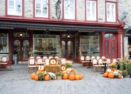 Photo of Quebec City Quebec City Sightseeing Tour A shopkeeper in Petit Champlain welcomes fall visitors to his place.