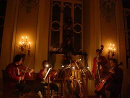 We got there early and grabbed the front table! Here's a picture of the performers - magical and I loved watching them play the violins. - June 2008