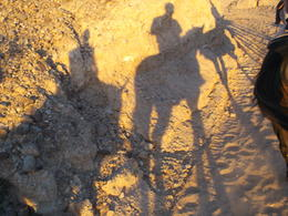 Photo of Las Vegas Wild West Sunset Horseback Ride with Dinner Riding off as the sun set