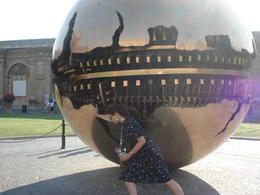 Our guide, Tiffany, made the sculpture rotate for us! , Christopher P - October 2012
