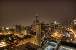 This photo was taken from the roof of our apartment. You can see iconic buildings like the Willis Tower, Trump Tower, Dearborn Station, CNA, the library, and our famous and quot;L and quot; tracks..., Kim - March 2011